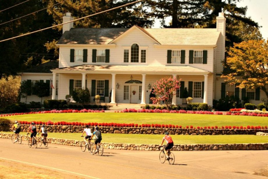 Road bike group passes house on self-guided Napa tour