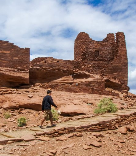Hiker approaches stone building on Grand Canyon trip