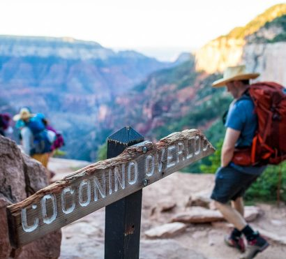 Hiking group passes Coconino Overlook sign in Grand Canyon