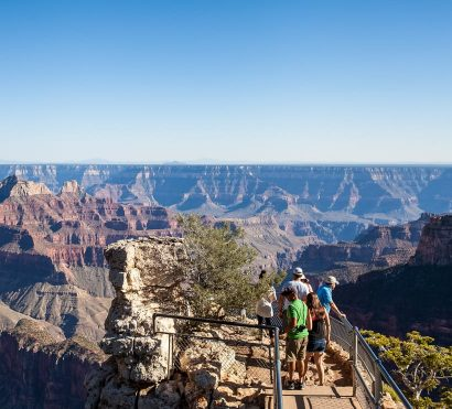 Hiking group stands on Grand Canyon North Rim overlook