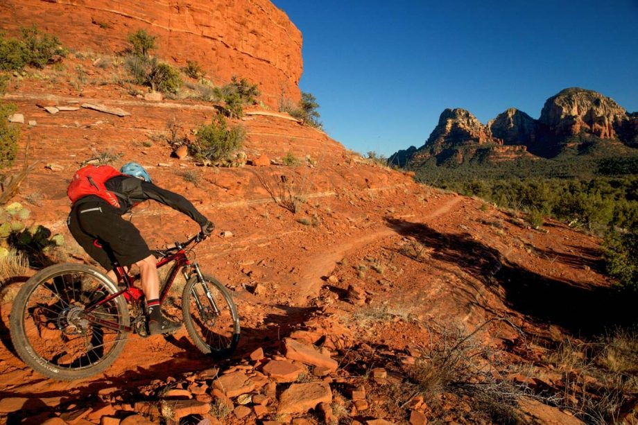 Mountain biker rides cliffside Sedona trail