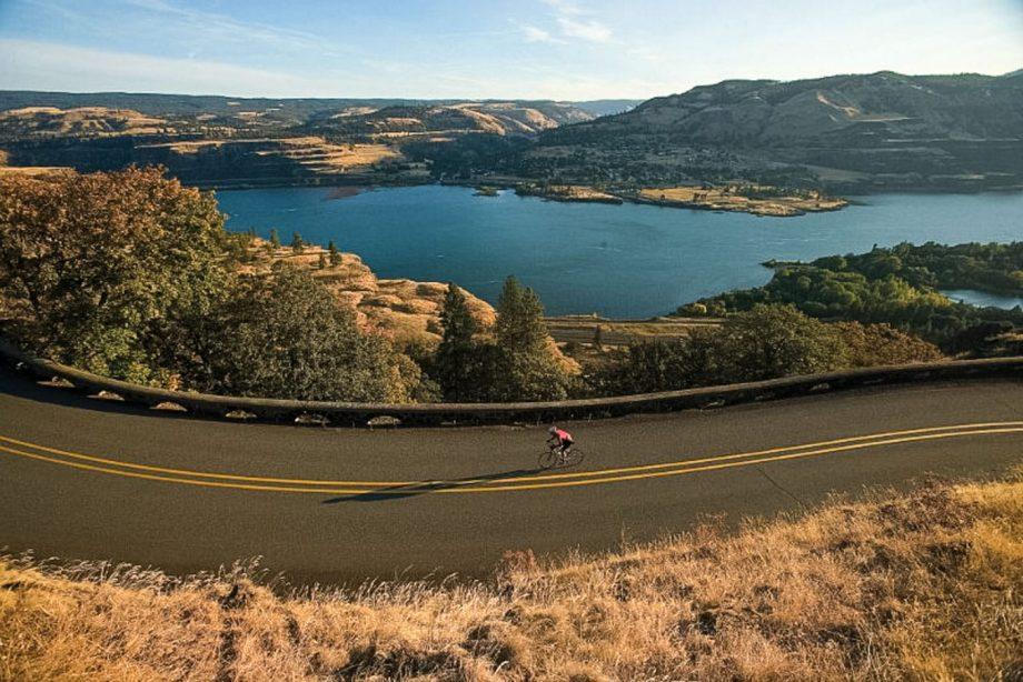Cyclist rides past lake on Sonoma road bike tour