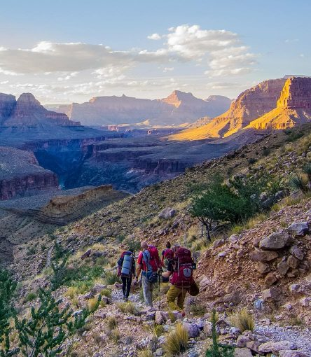 Hiking group descends rocky trail on Grand Canyon trip