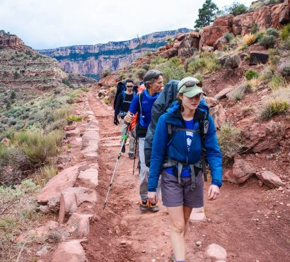 Hiking group climbs trail on Grand Canyon backpacking trip