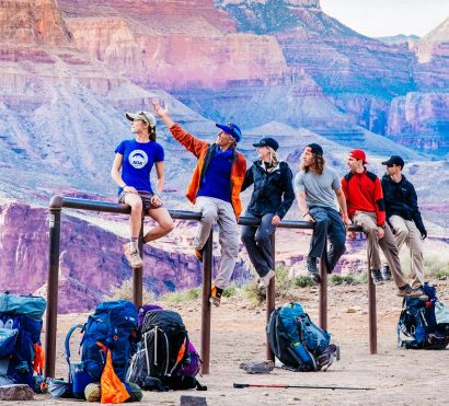 Grandview Trail backpacking tour group sits on rail