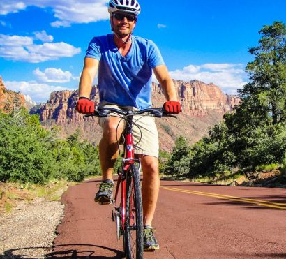 Cyclist rides southern Utah on road biking tour