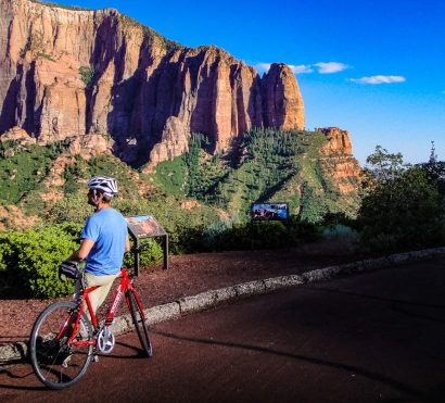 Cyclist looks at cliffs on Southern Utah biking tour