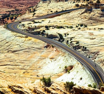 Aerial view of cyclist on southern Utah desert road