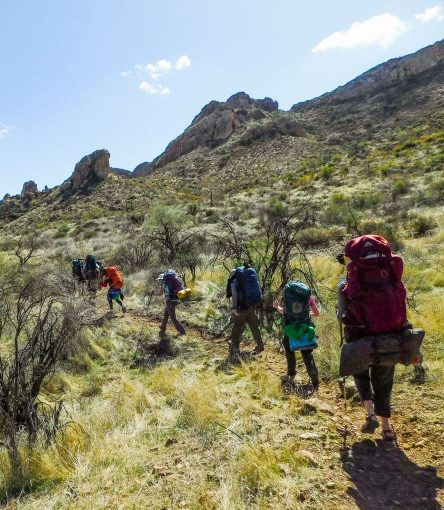 Hiking tour group crosses Superstition Mountains Wilderness