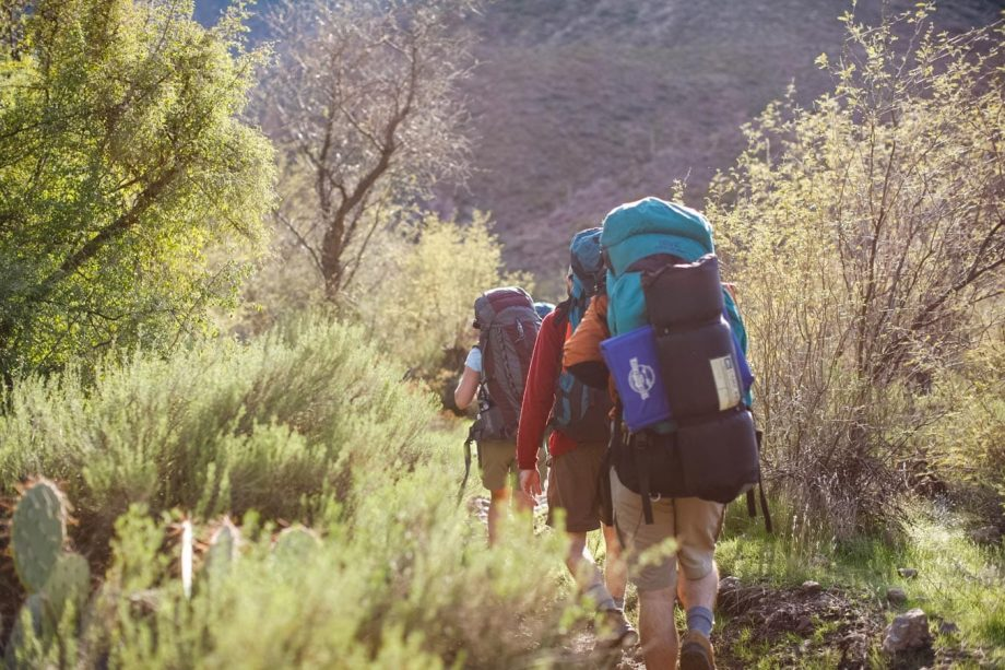 Hikers traverse desert on Superstition Mountains backpack tour