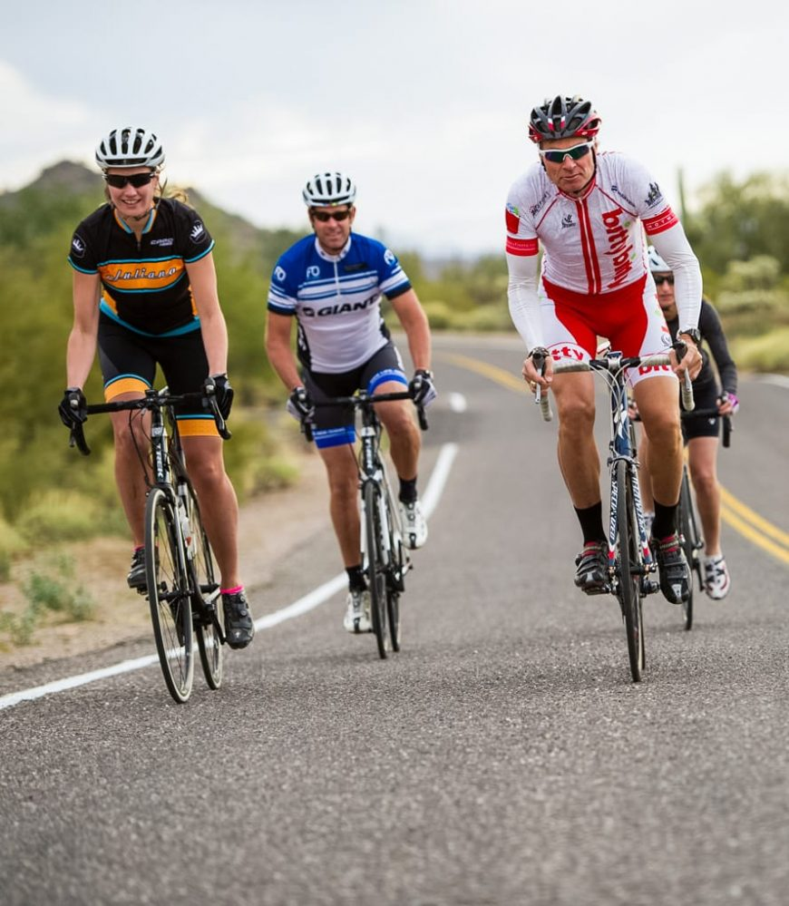 Road cyclist group rides down Tucson road