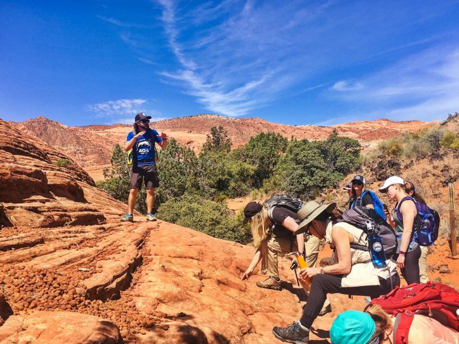 Tour guide talks to hikers at Utah national park