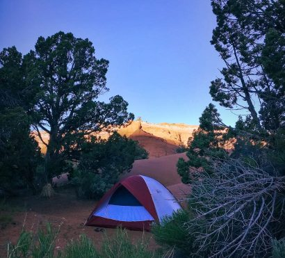 Camping tent in shadows on Utah national park hiking trip
