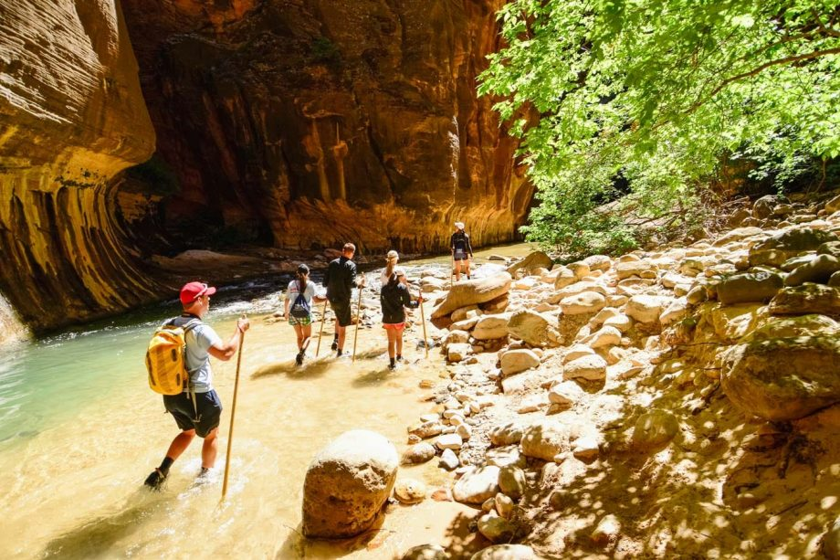 Hiking group crosses stream on Zion National Park trip