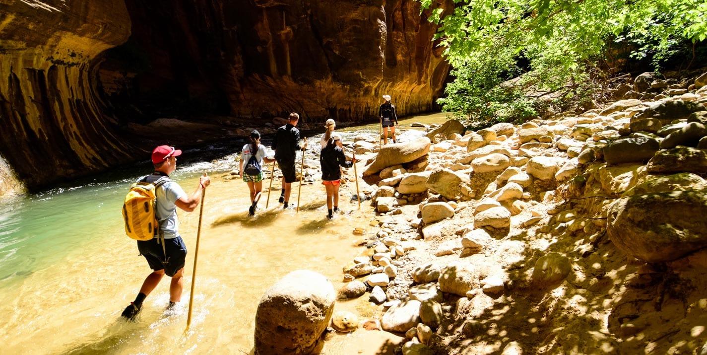 Hiking through the Zion Narrows on a Custom Utah Adventure Tour