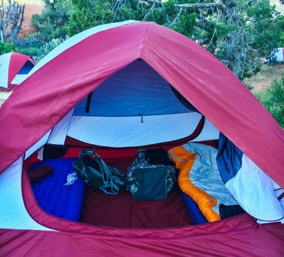 Open camping tent on Zion National Park hiking trip