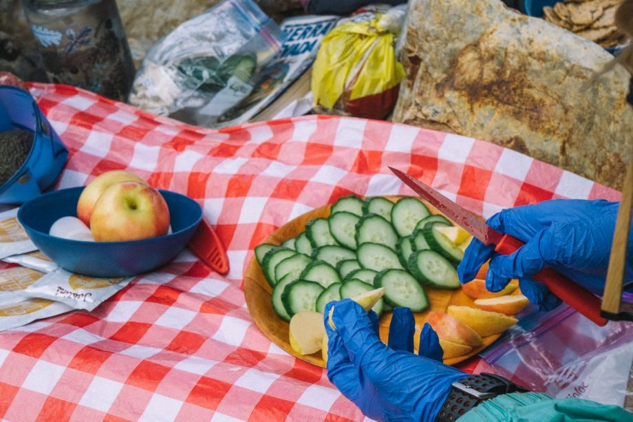 Hiker cuts fruit for Yosemite backpacking trip lunch