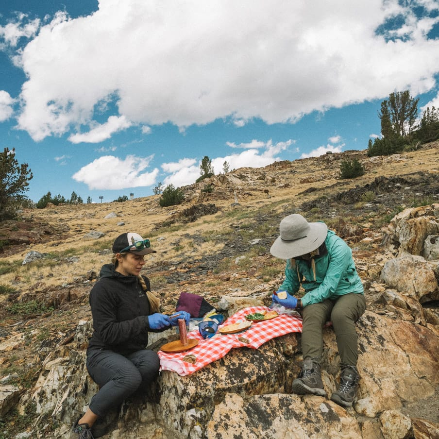Hikers prepare picnic lunch on the rocks of Yosemite