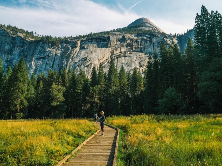 Hikers cross wooden trail on Yosemite National Park trip