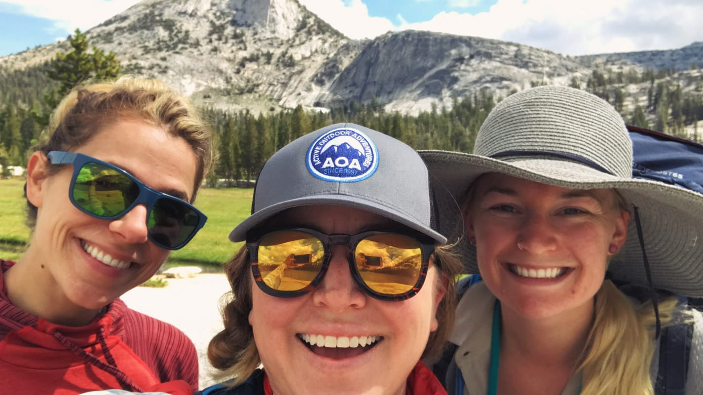 Smiling hikers take selfie on Cathedral Lakes trip