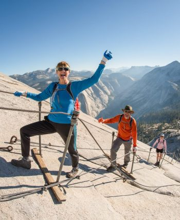 Victorious hikers climb Yosemite National Park Half Dome