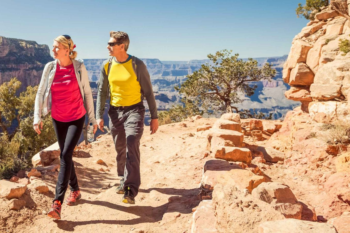 Hikers look over Grand Canyon on multi-day hiking trip