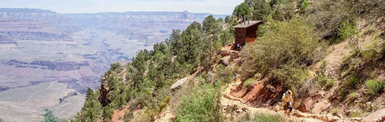 Hikers climb overlook trail on Grand Canyon Rim to Rim trip