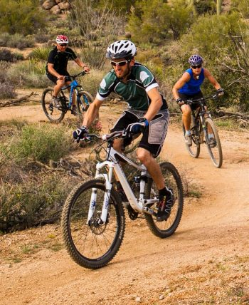 Mountain bike tour group on Arizona desert trail