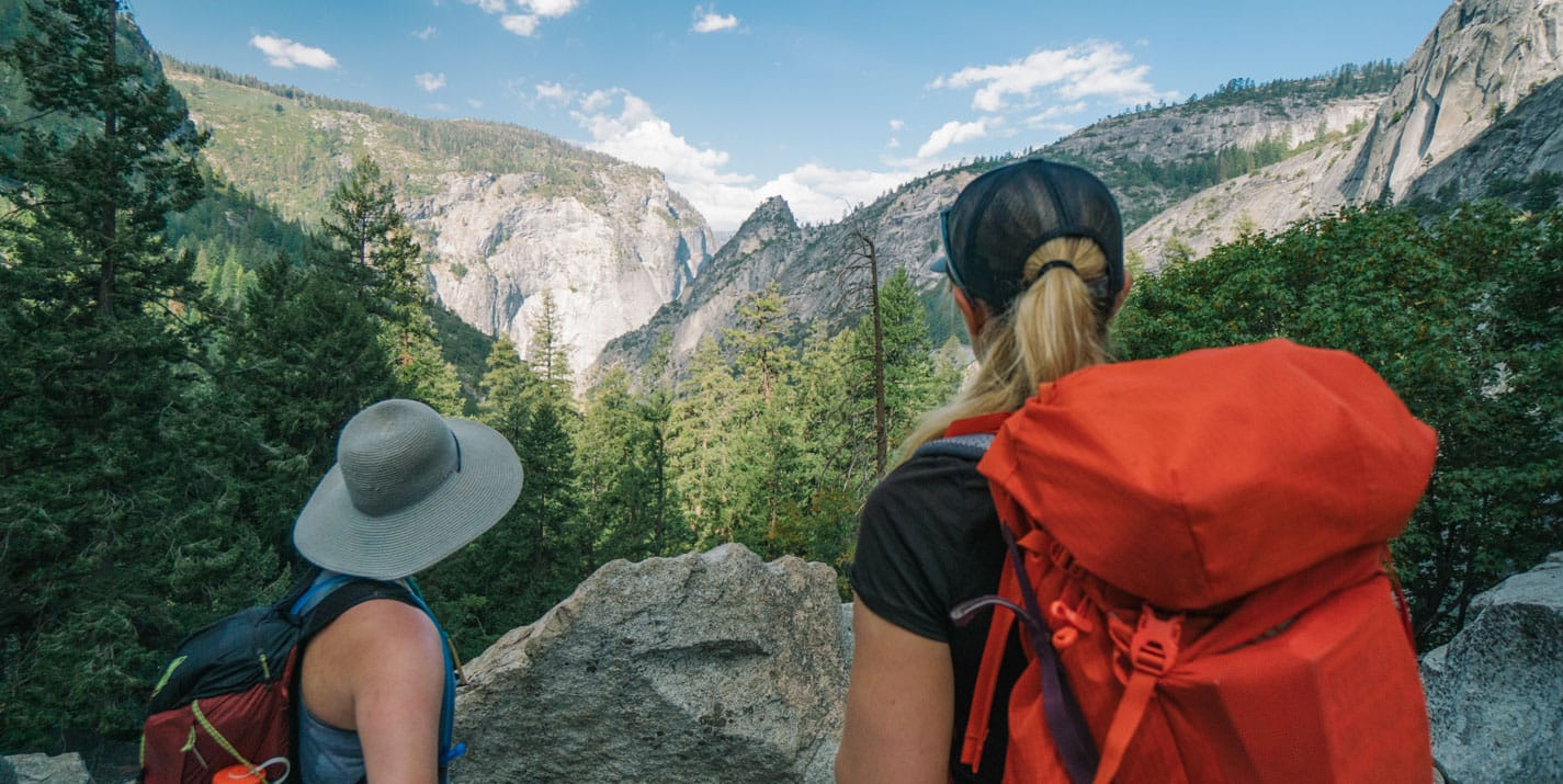 Hikers overlook canyon on Yosemite National Park tour.