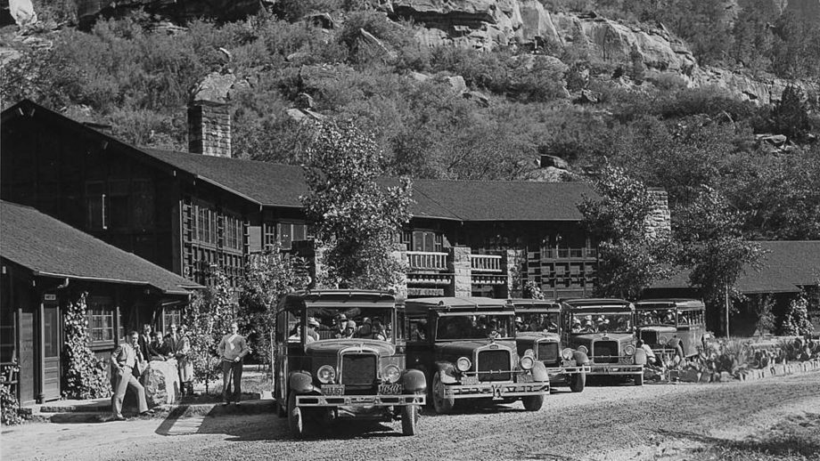 Black and white historic Zion Lodge with vintage cars