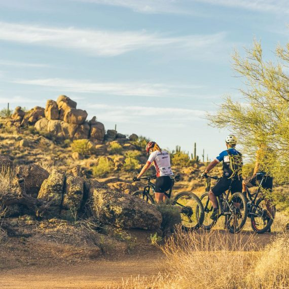 desert mountain biking past boulders on Arizona mountain bike trip
