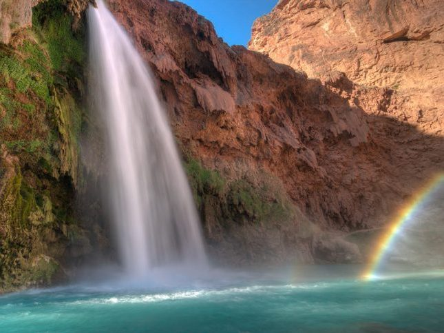 Havasu Falls and rainbow in morning light.