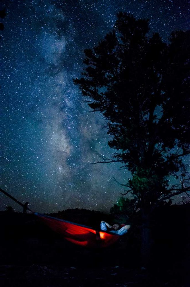 Camper in a hammock viewing the stars