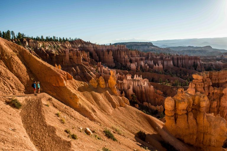 Two hikers enjoy the views of Bryce Canyon National Park.