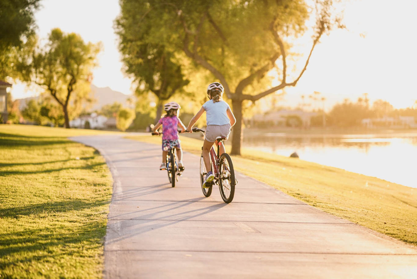 two kids biking the greenbelt path in Scottsdale Arizona