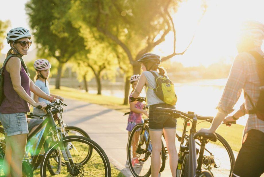 family riding bikes on greenbelt tour in Scottsdale Arizona