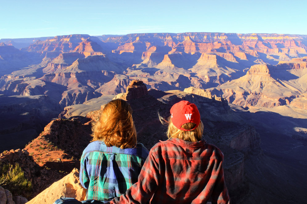 Two hikers overlook the Grand Canyon from the South Rim