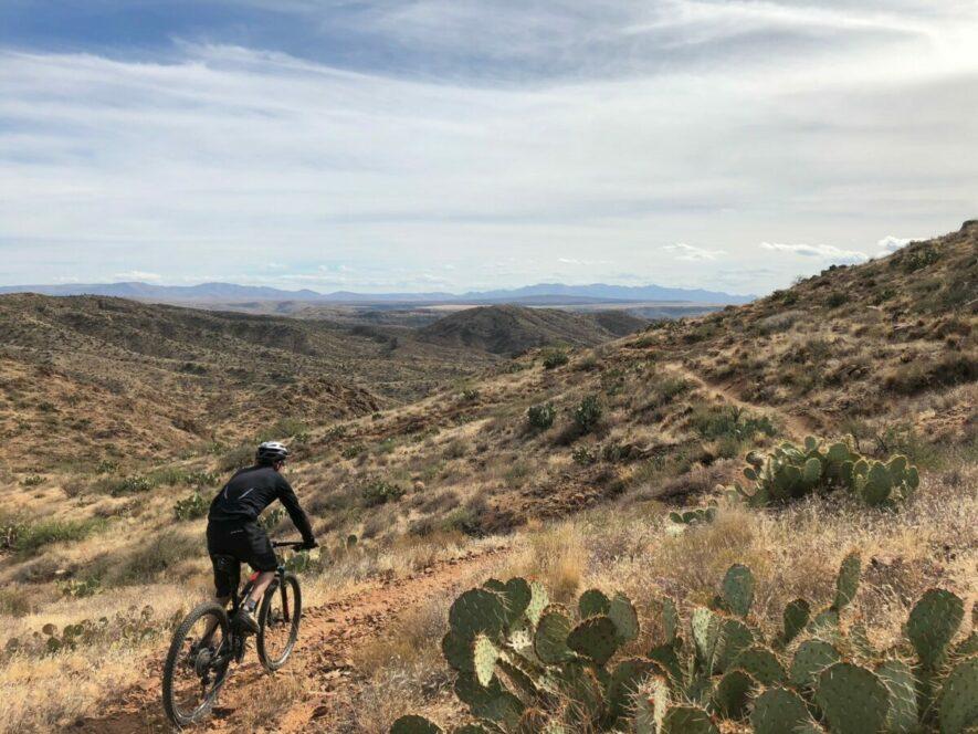 mountain biker rides along a ridgeline on the Black Canyon trail in Arizona