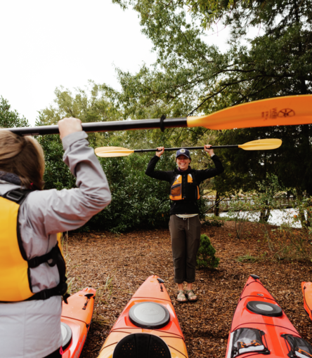 Kayak instructor prepares to launch with group